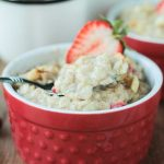 bowl of oatmeal topped with fresh strawberry