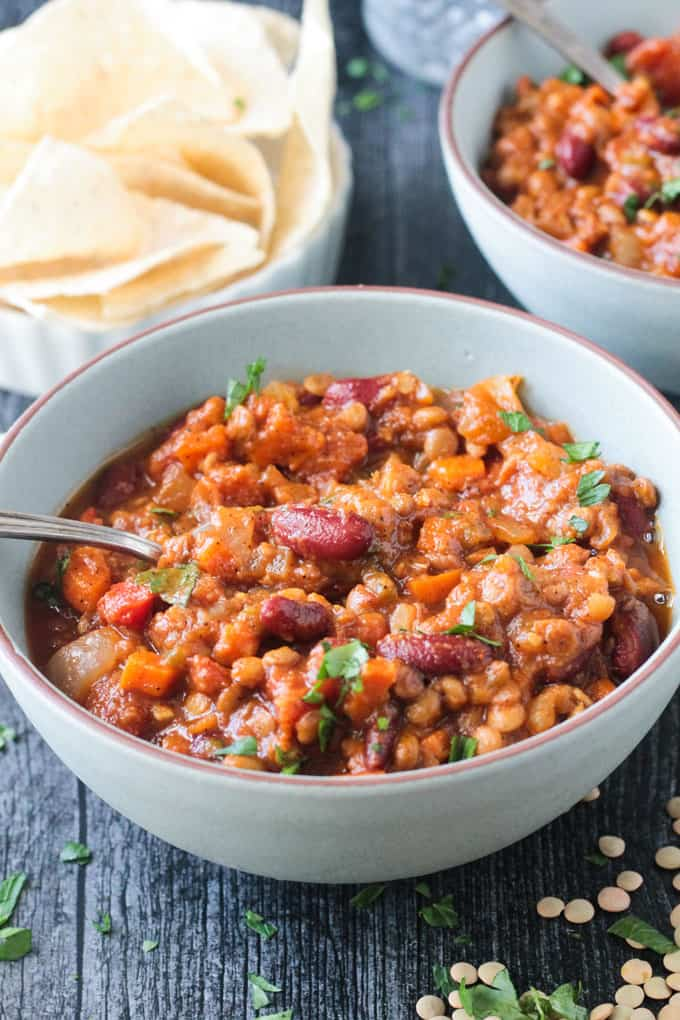 Up close of a bowl of chili with lentils and beans