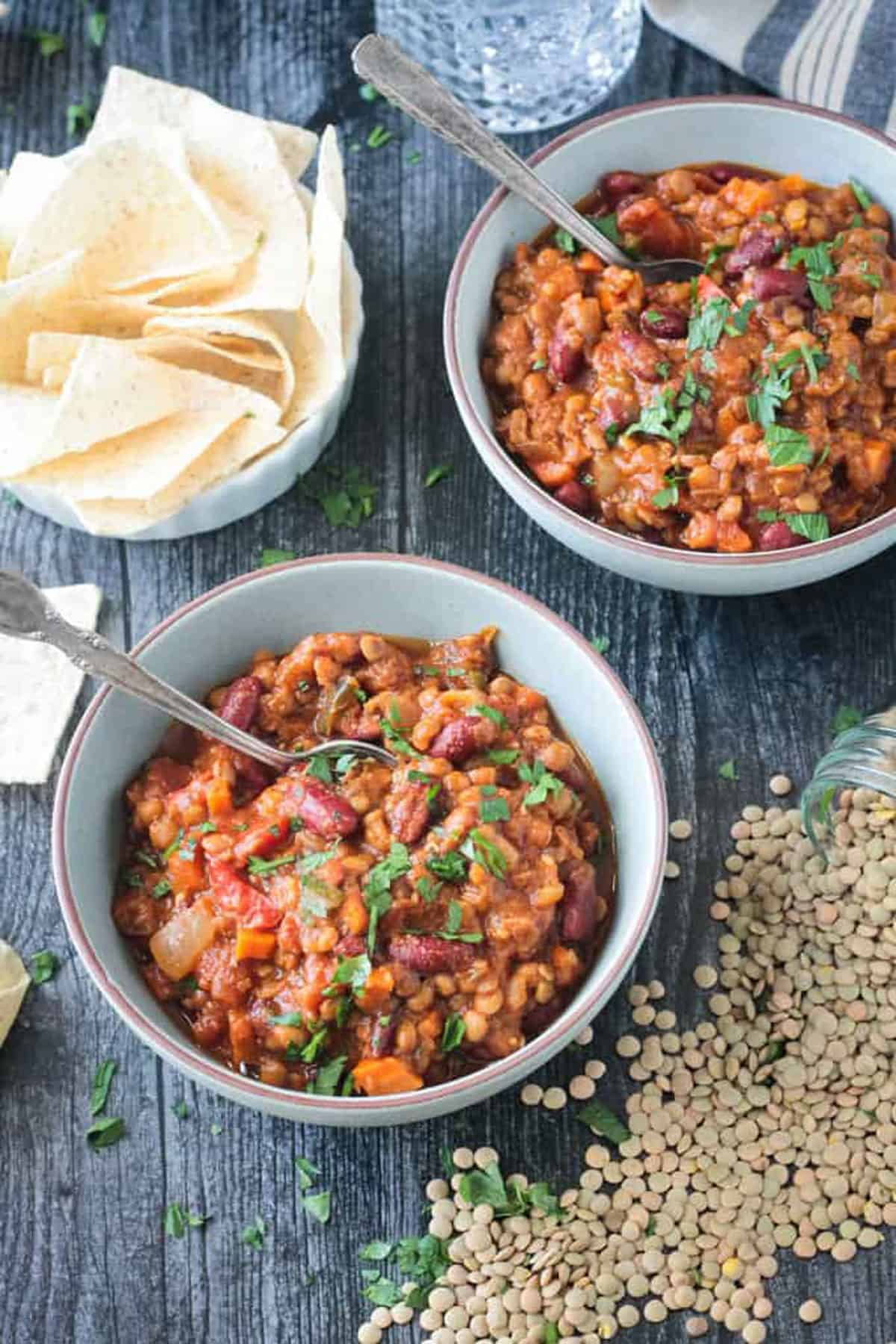 Spoon in a bowl of thick lentil chili.