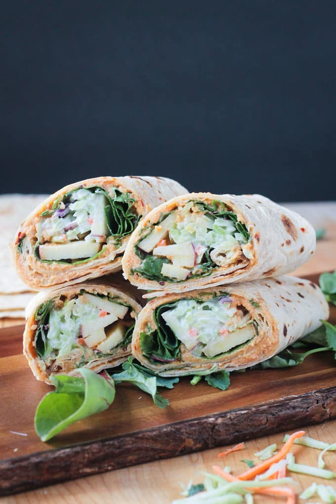 Four veggie tortilla wraps stacked up.