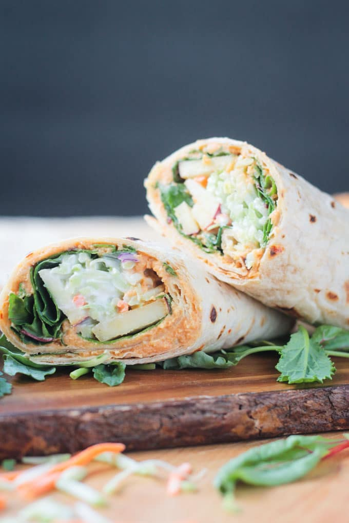 One veggie tortilla wrap stacked on top of another.