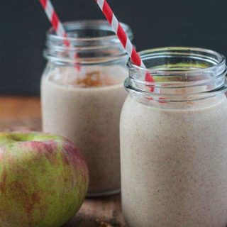 two apple smoothies in glass jars