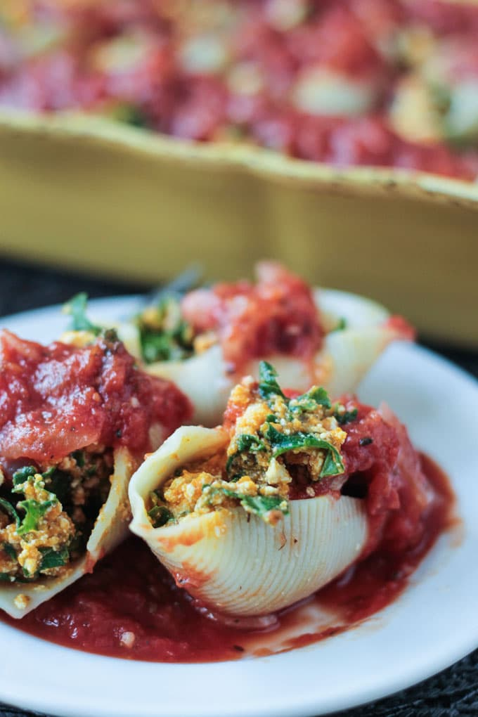 Close up of one Pumpkin & Kale Vegan Stuffed Shells on a plate.