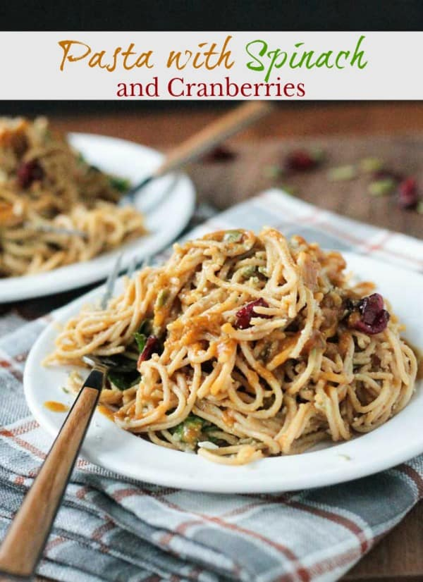 Spaghetti with Spinach and Cranberries in a Creamy Pumpkin Maple Glaze - this dish comes together in less than 20 minutes. The perfect fall pasta for a weeknight meal! Kid approved! #vegan #pasta #spaghetti #pumpkin #fall #autumn #thanksgiving #halloween #meatless #vegetarian #dairyfree #30minutemeal #quickandeasy