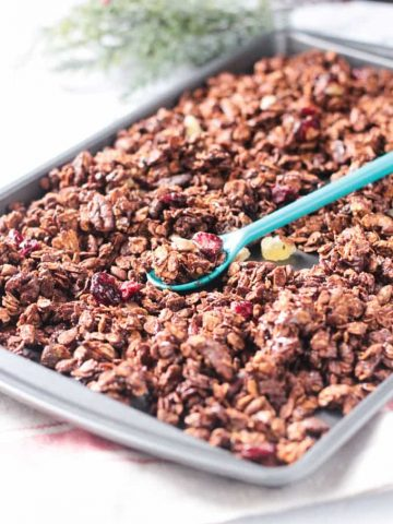 Baking tray full of gingerbread gluten free granola.