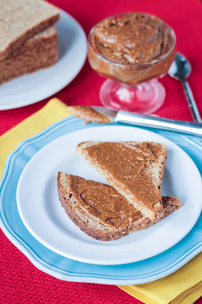 Gingerbread Cashew Butter on slices of toast and plate.