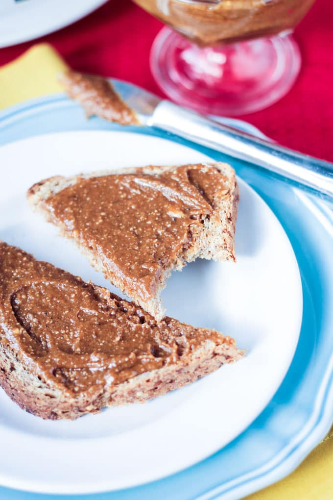 Gingerbread Cashew Butter on toast with a bite taken out one of the slices.