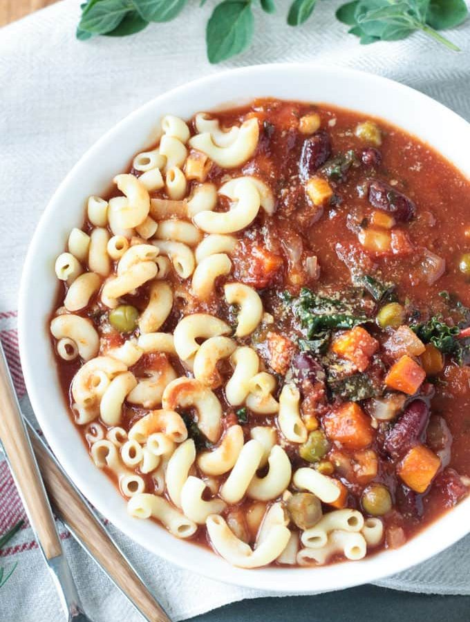 Macaroni noodles in a bowl of minestrone soup