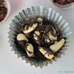 raw cashews drizzled in chocolate