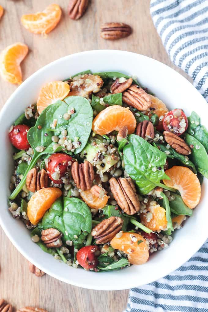 Lentil Quinoa Salad w/ Spinach and Citrus. Garnished with pecans.