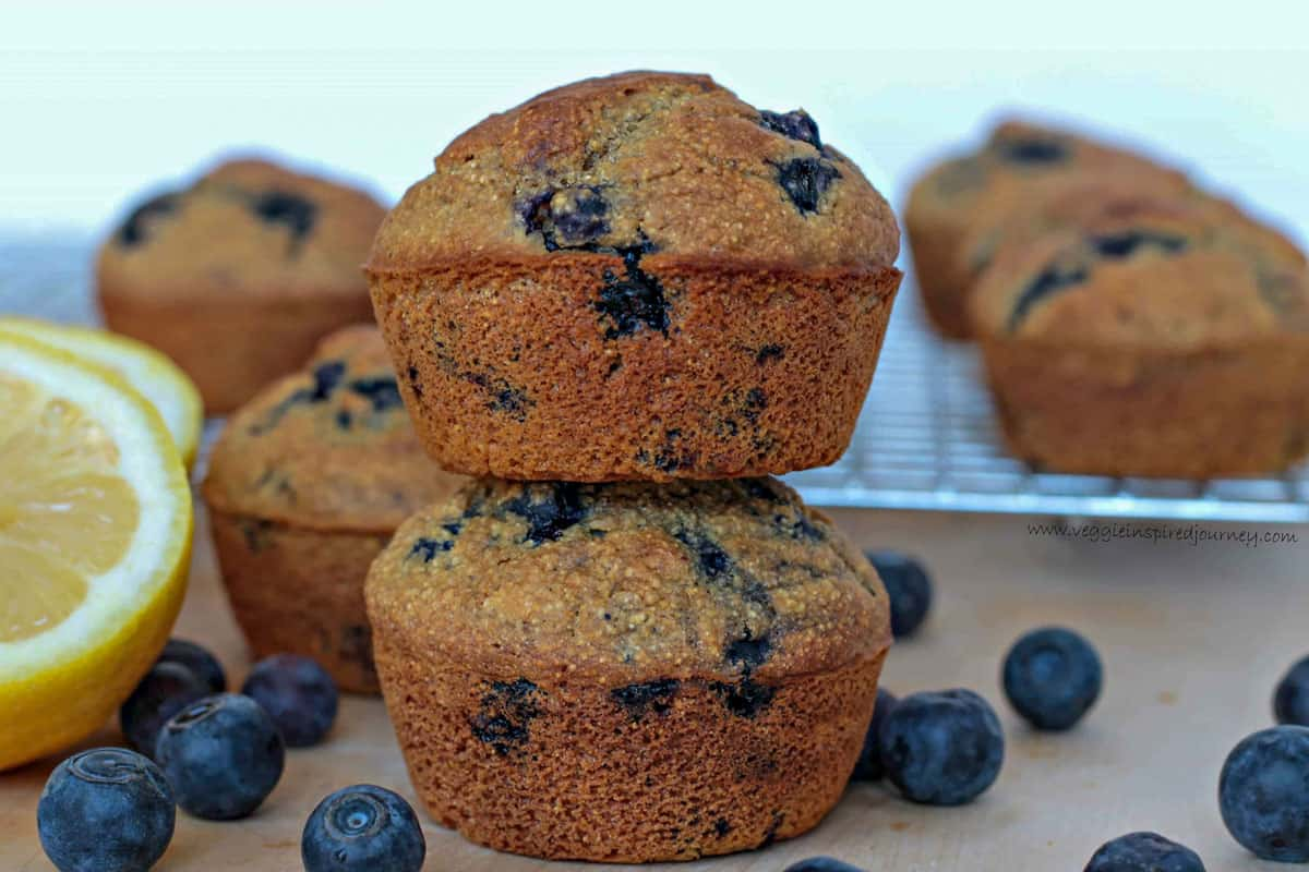 Stack of two lemon blueberry cornmeal muffins.
