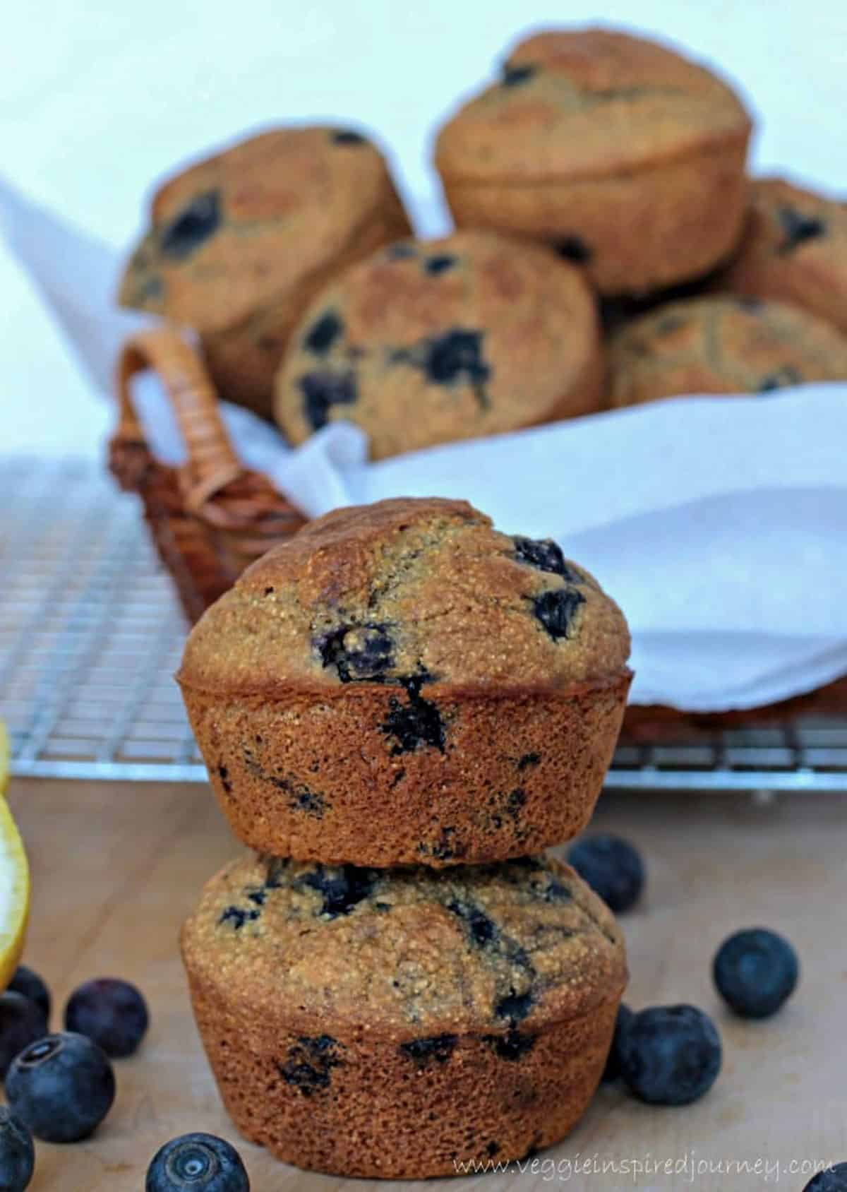 Blueberry cornmeal muffins stacked on top of each other.