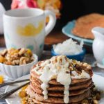 Carrot cake pancakes drizzled with sweet cashew cream cheese frosting.