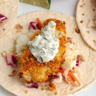 crispy cauliflower on a tortilla topped with tartar sauce