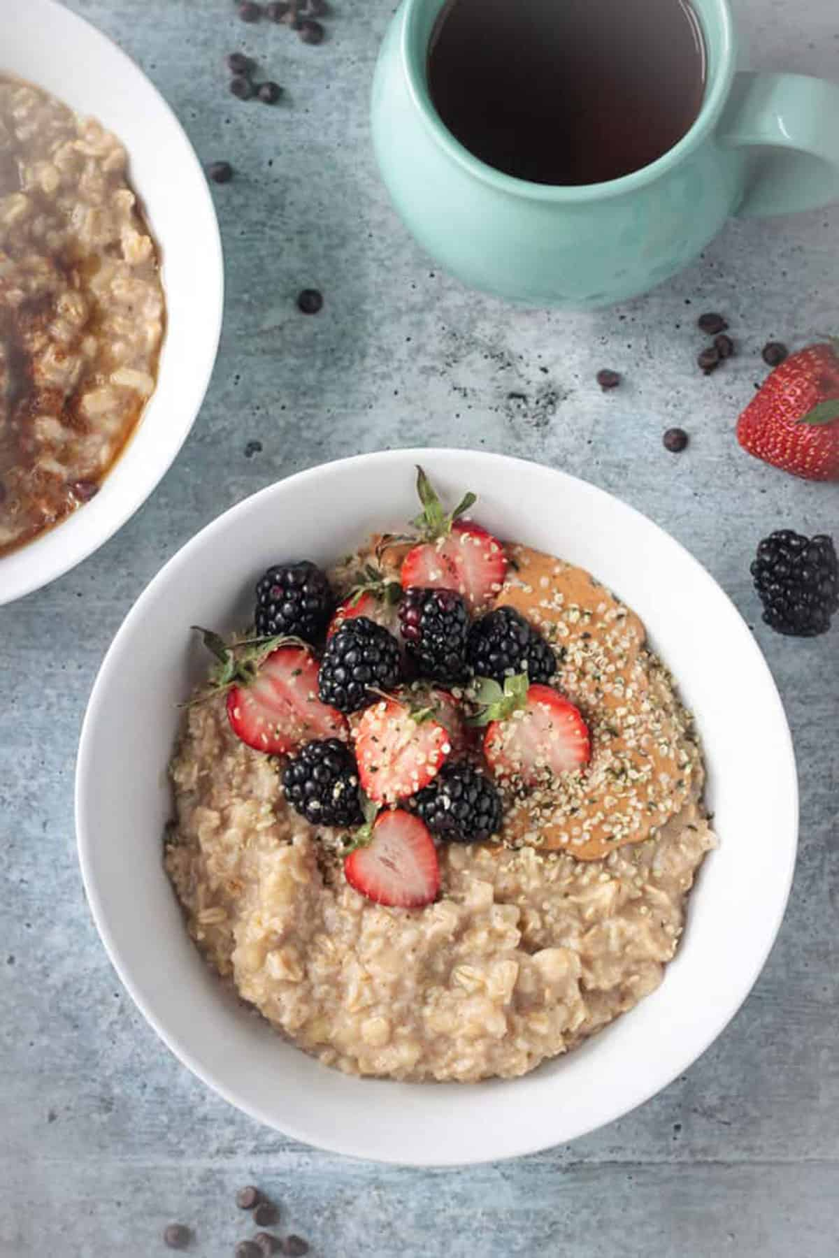 Overhead view of healthy oatmeal topped with berries and hemp seeds.