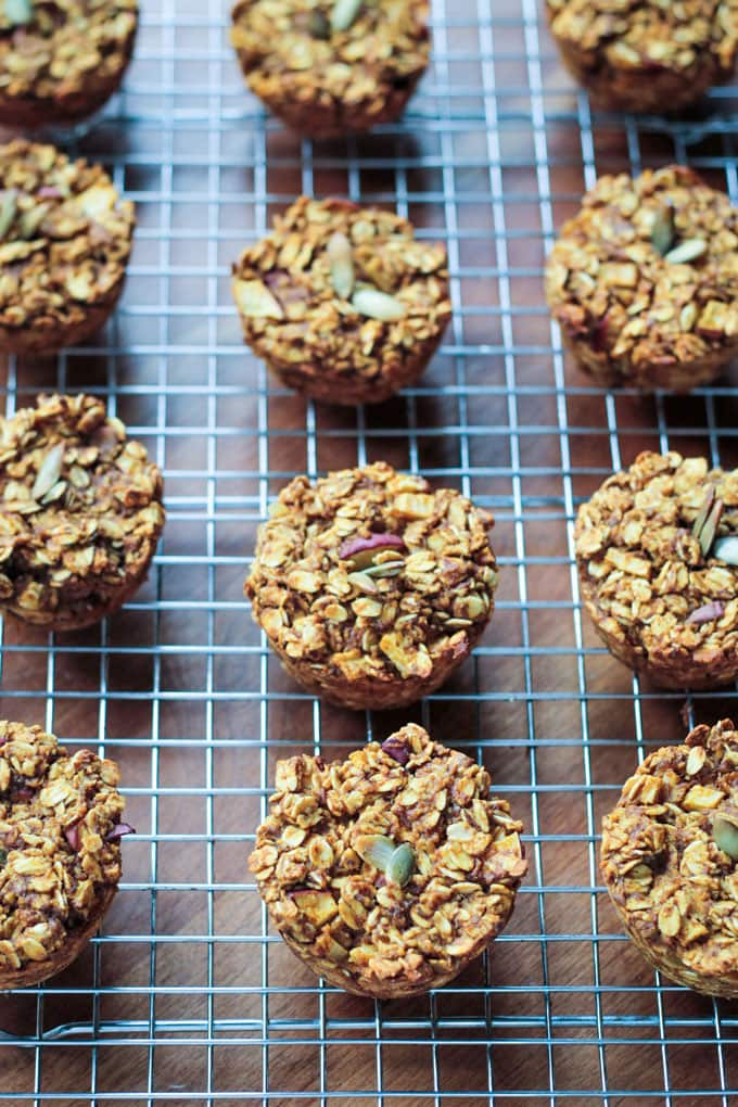 Apple Pumpkin Pie Baked Oatmeal Muffins in rows on a cooling rack.