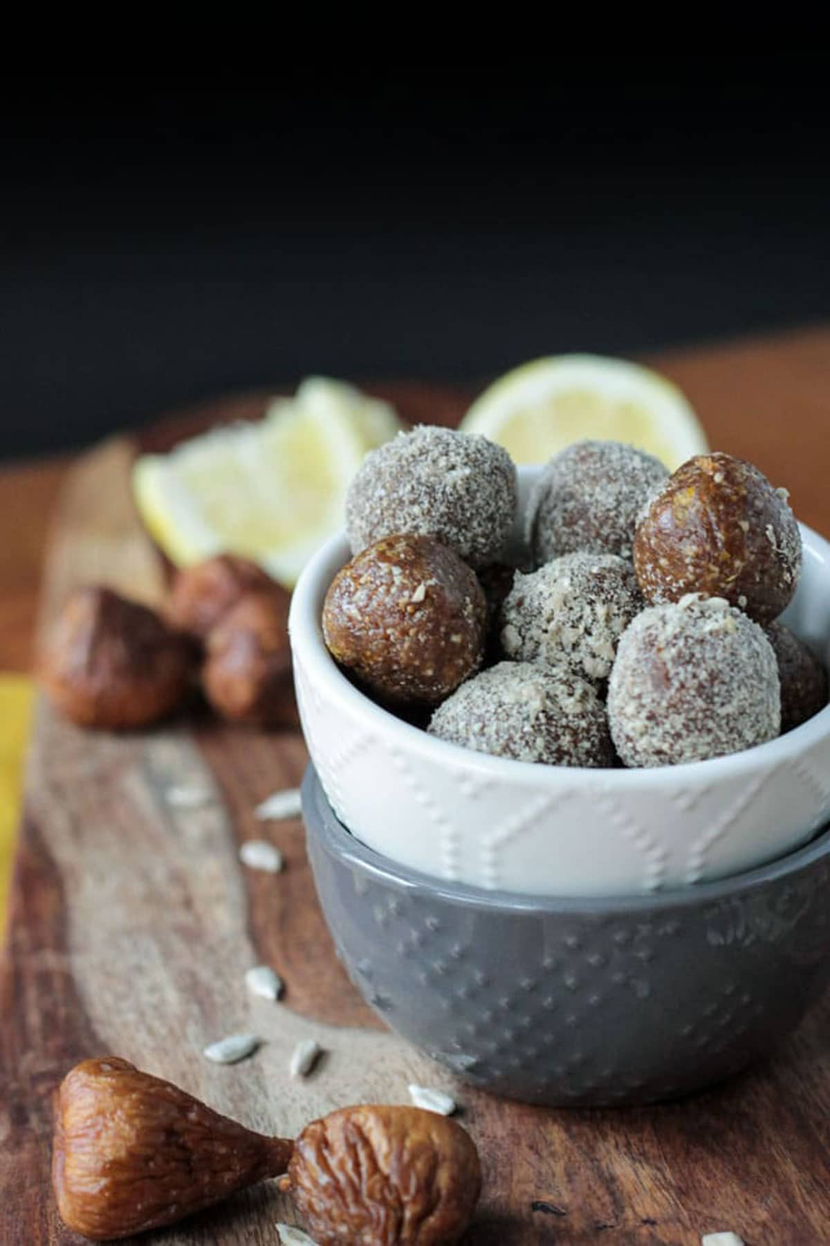 A pile of sunflower fig balls in a white bowl.