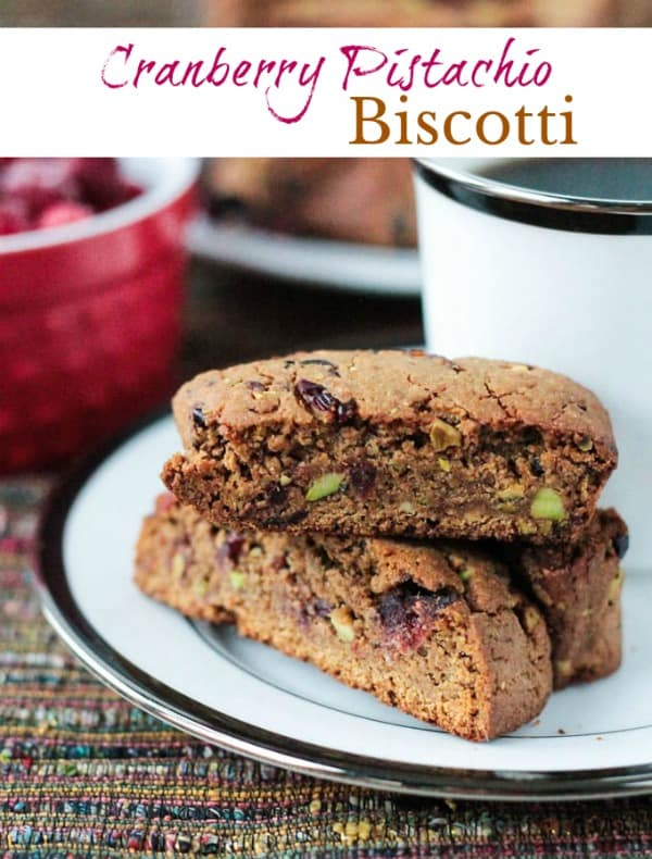 Whole Wheat Cranberry Pistachio Vegan Biscotti - This recipe is so easy! A festive vegan biscotti with NO oil, NO butter, NO dairy, NO refined sugar...only good for you ingredients so you won't feel guilty reaching for more than one! The perfect Thanksgiving or Christmas treat with a cup of coffee or tea. #vegan #cranberries #holiday #christmas #biscotti #cookies #pistachios #easy #dairyfree #oilfree