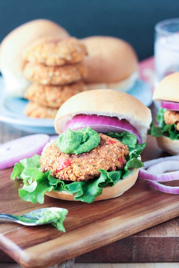 Dollop of herbed white bean spread on top of a veggie patty