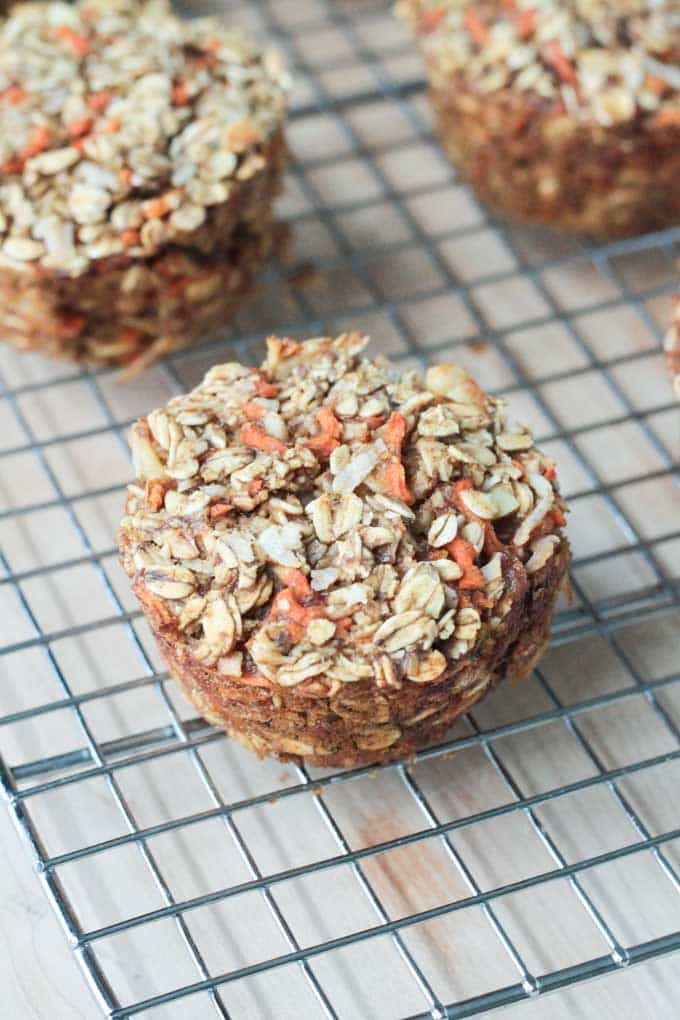 Carrot Cake Baked Oatmeal muffins on a wire cooling rack.