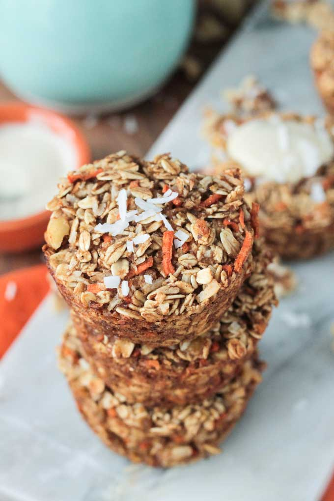 Overhead view of a stack of 3 Carrot Cake Baked Oatmeal muffins