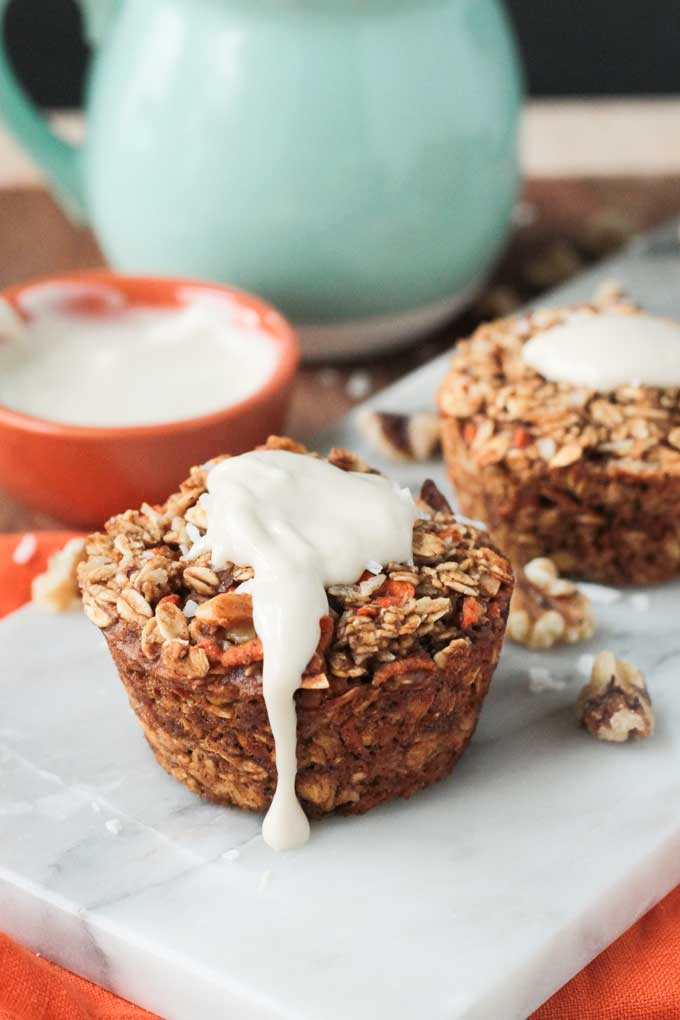 Carrot Cake Baked Oatmeal topped with sweet cashew cream cheese frosting