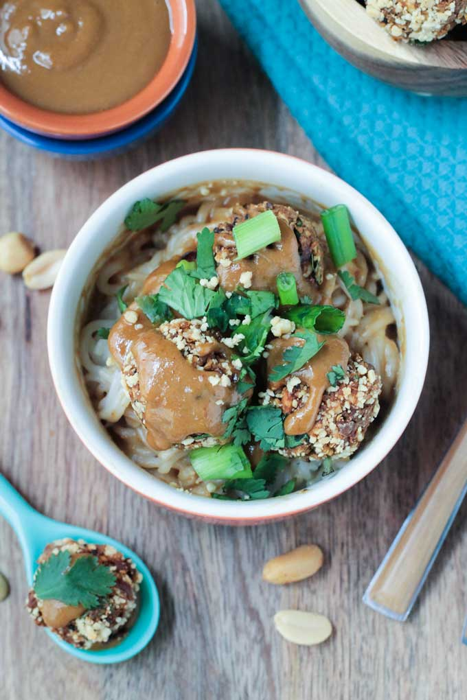 Thai Quinoa Meatballs over rice noodles and garnished with crushed peanuts, cilantro, and scallions.