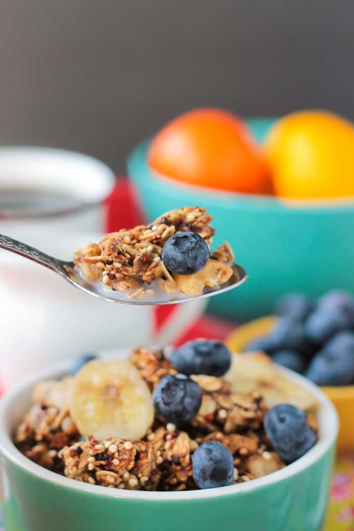 Spoonful of Banana Bread Granola with a fresh blueberry.