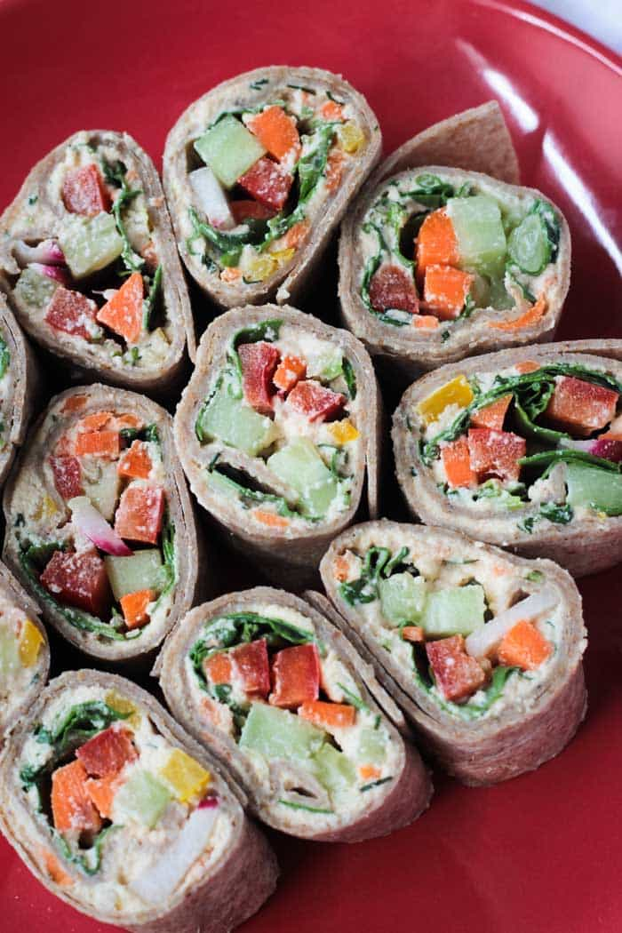 Veggie Tortilla Rollups arranged in a circle on a red plate.