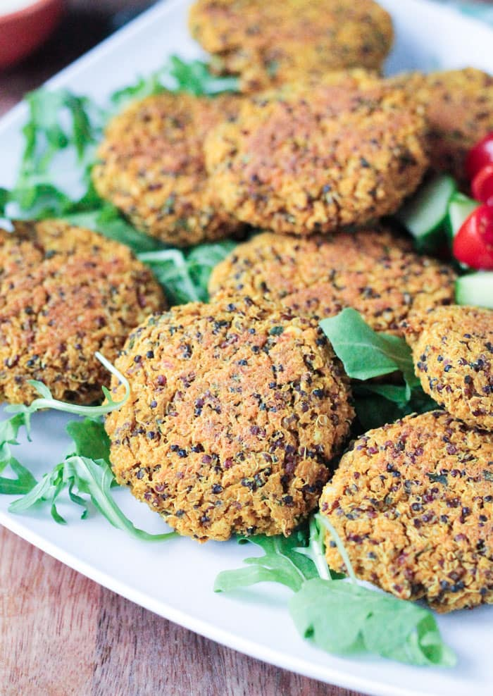 Close up of Baked Red Lentil Quinoa Fritters on a plate.