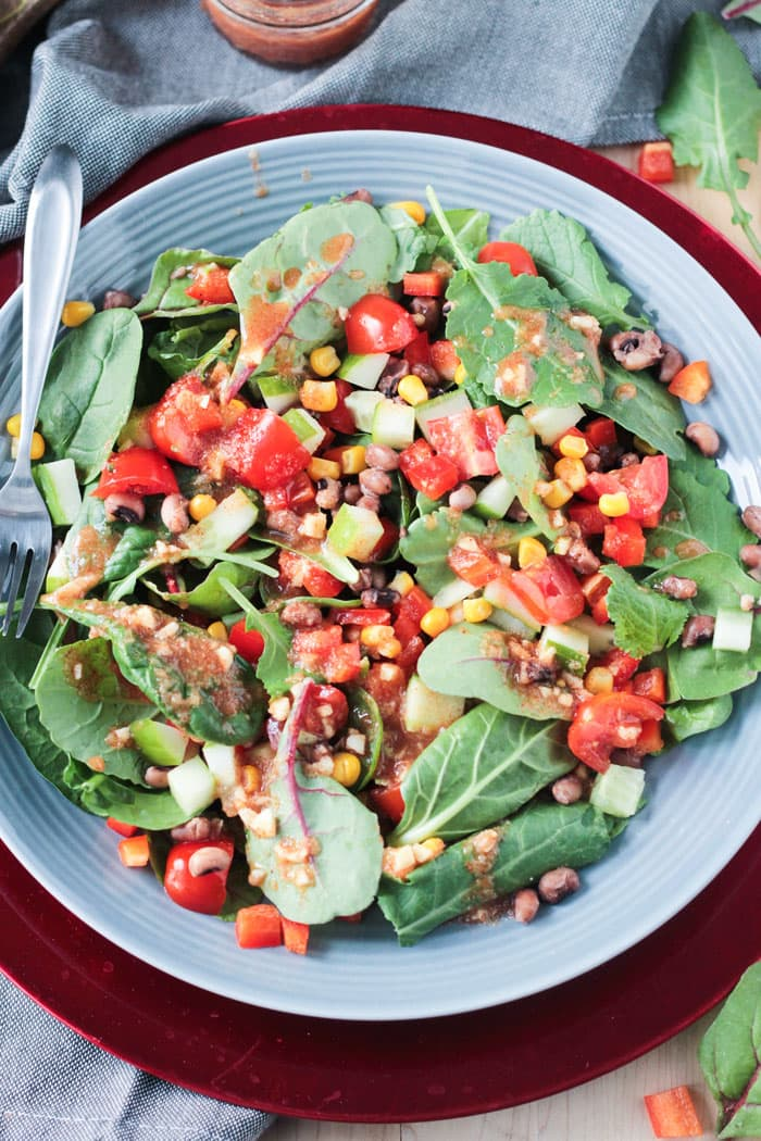 Black Eyed Peas Salad w/ Baby Power Greens, tomatoes, peppers, and corn.