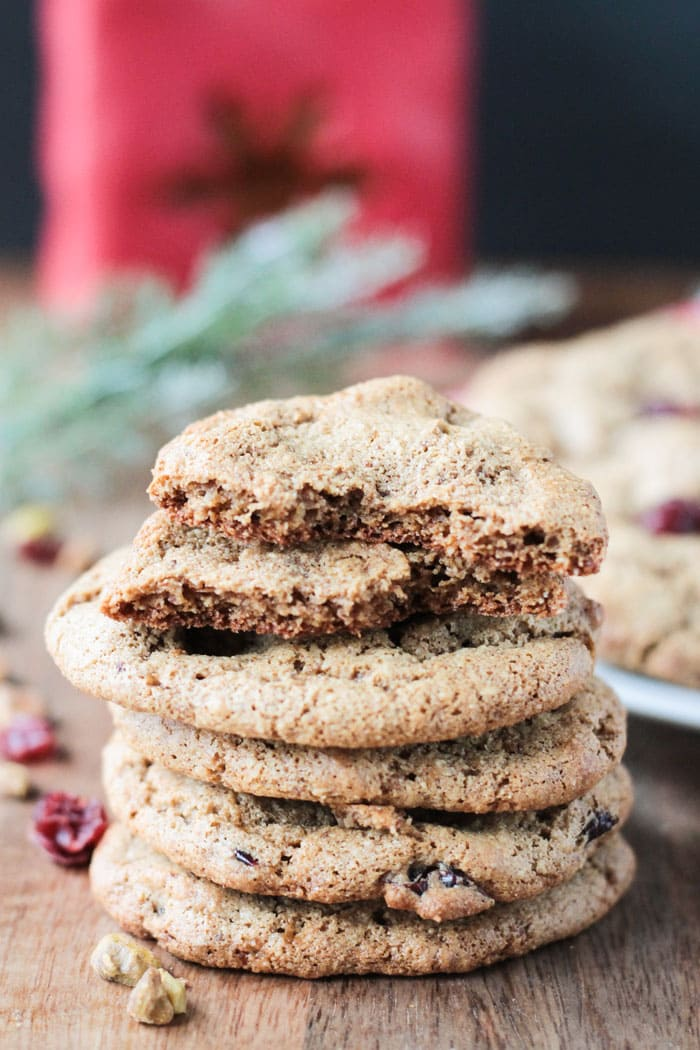 Stack of cookies. Top cookie is broken in half showing the chewy inside.