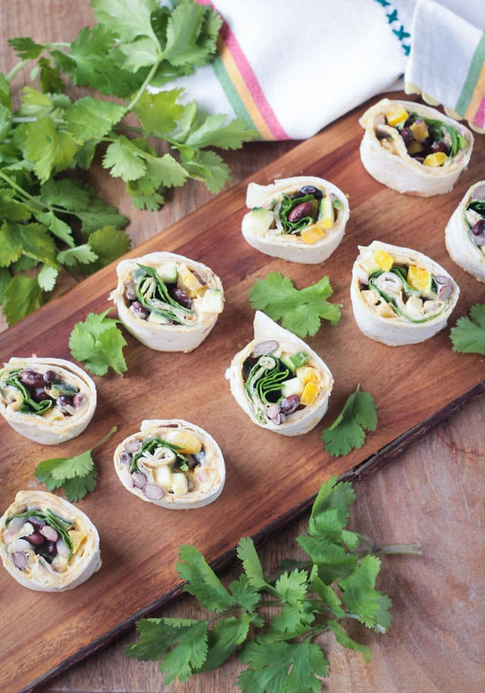 Southwest Roll Ups - easily made gluten free by using corn tortillas. The perfect party appetizer or snack!