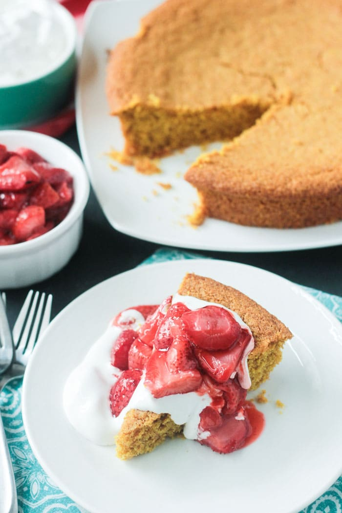 Roasting the fresh strawberries bring out their sweetness and they pair perfectly with this vegan Vanilla Corn Cake.