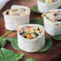 Southwest Roll Ups - the perfect party appetizer for your vegetarian and vegan friends. Full of flavor and protein, these little bites will please meat eaters too!