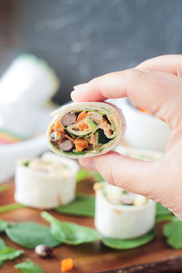 Southwest Roll Ups - an easy vegetarian party appetizer. Full of black beans, spinach, peppers, onion, and cilantro - it's your favorite Mexican flavors rolled up into tortillas and made bite size.