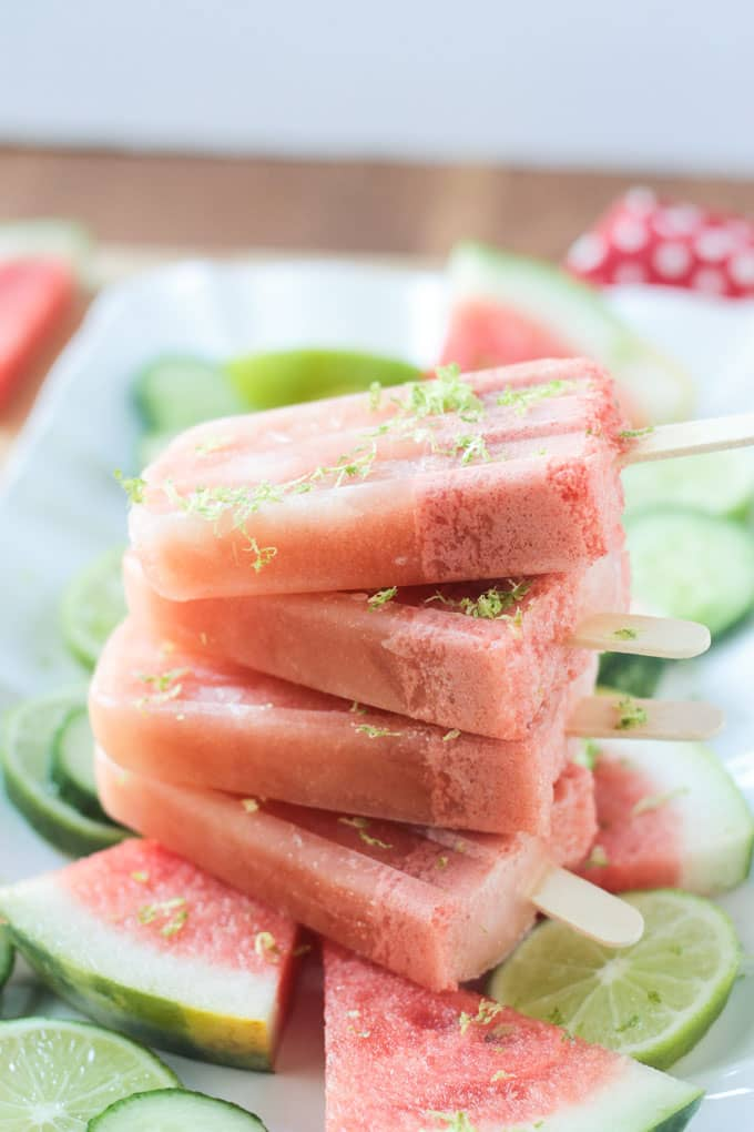 Stack of four watermelon popsicles.
