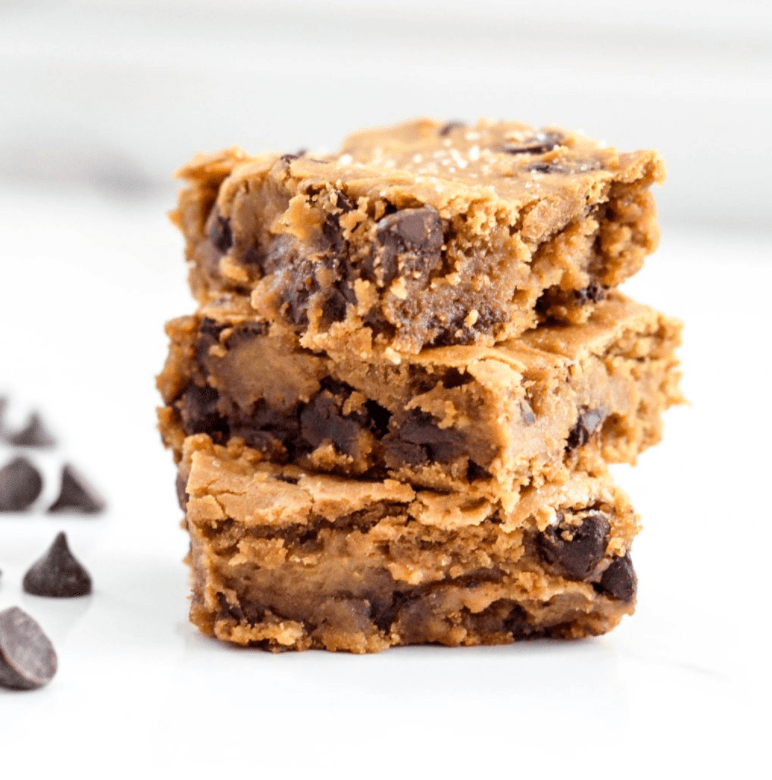 A stack of three Peanut Butter Chocolate Chip Blondies
