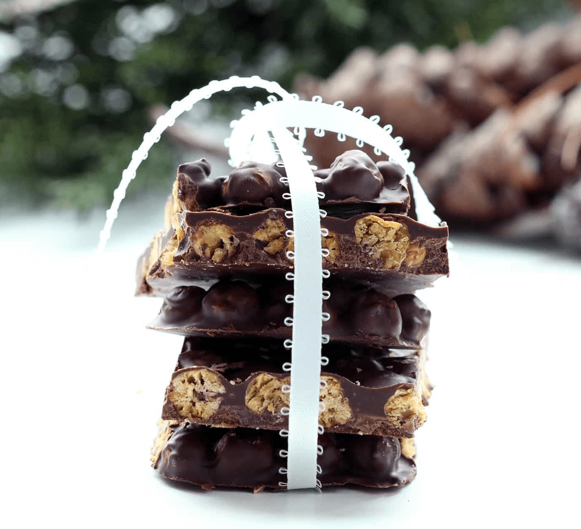 Stack of chocolate chickpea bark tied with a white ribbon.