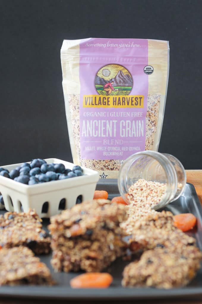 Village Harvest new rice blend product - Ancient Grains - behind a tray full of breakfast bars and blueberries.