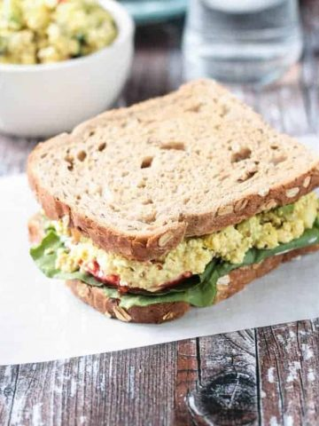 Overhead view of Curried Tofu Salad Sandwich on whole grain bread.