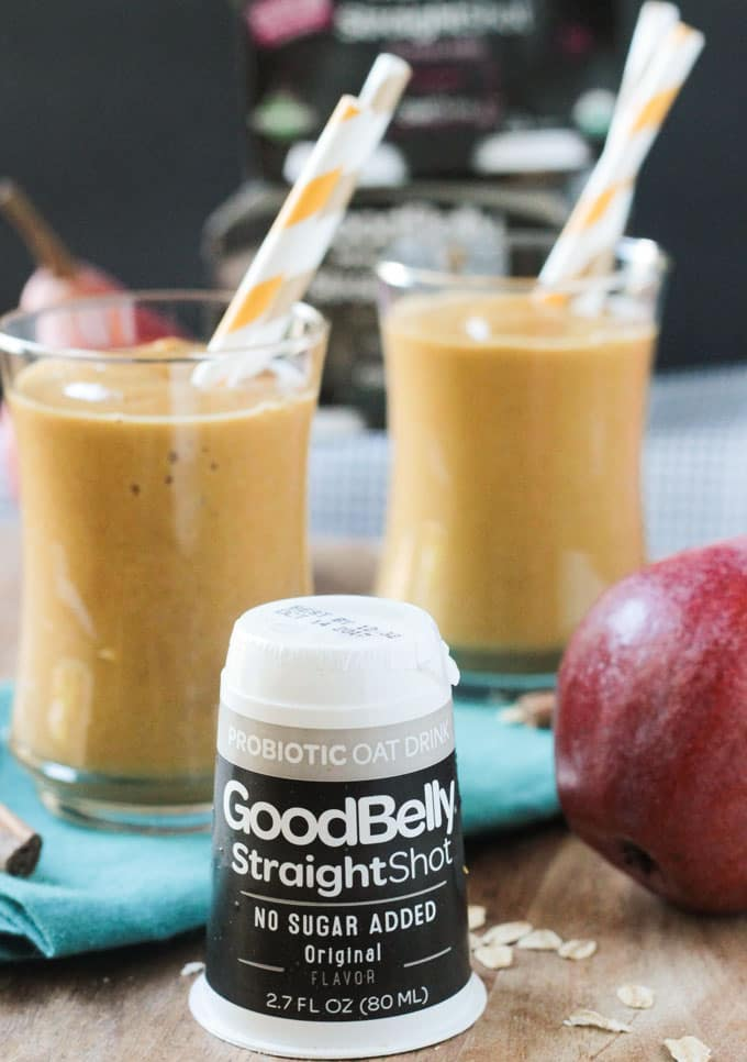 Good Belly Straight Shot Probiotic product in front of two glasses full of pumpkin smoothies.