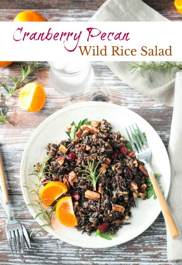 This Cranberry Pecan Wild Rice Salad would be the perfect side dish for your Thanksgiving or Christmas holiday table. Wild rice is high in protein (a complete protein!), nutty in flavor and has a nice chewy bite. Paired with the sweet tangy cranberries and buttery pecans, this dish is a flavorful winning combo. Try it for a light, but filling, lunch anytime of the year too! #vegan #glutenfree #sidedish #wildrice #oilfree #holiday #thanksgiving #christmas #salad #cranberries #pecans
