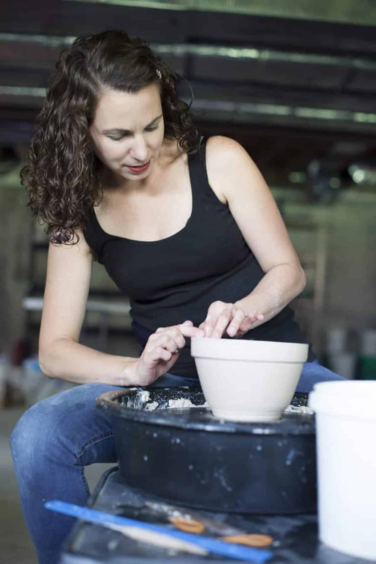 Potter, Lindsay Klix, in the process of making a bowl.
