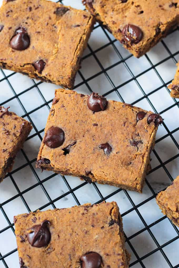 Overhead view of a pumpkin chocolate chip bars cooling on a wire rack.