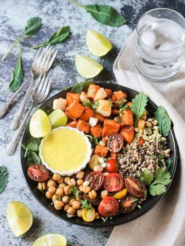Three forks lie next to a Sweet Potato Quinoa Bowl with Cashew Curry Sauce.