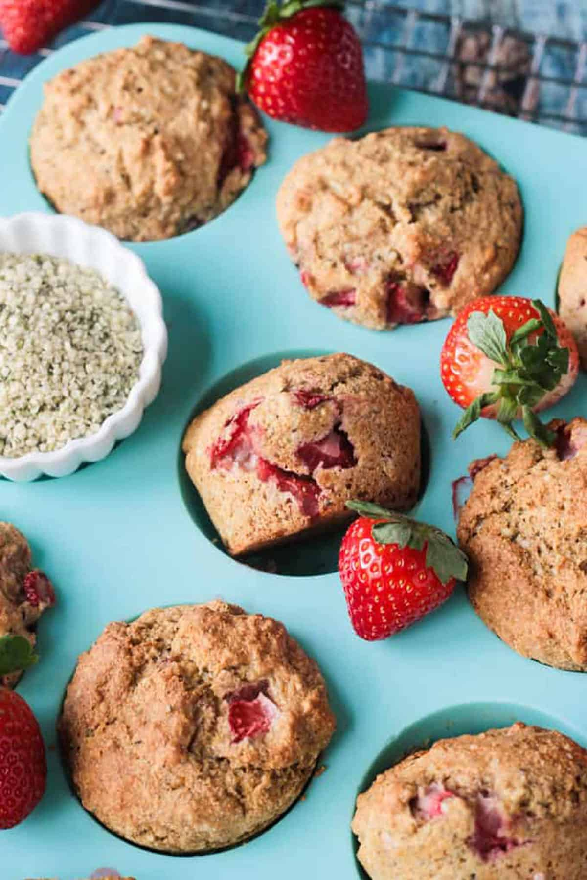Close up of strawberry pieces in a golden brown muffin.