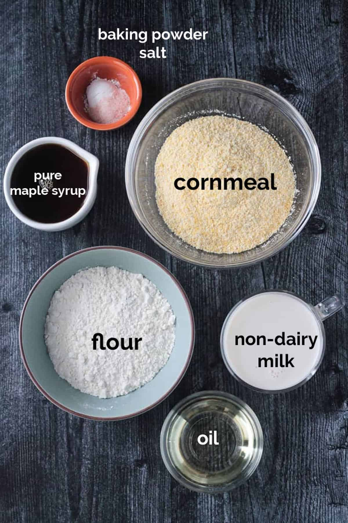Recipe ingredients for the crust arrayed in individual bowls.