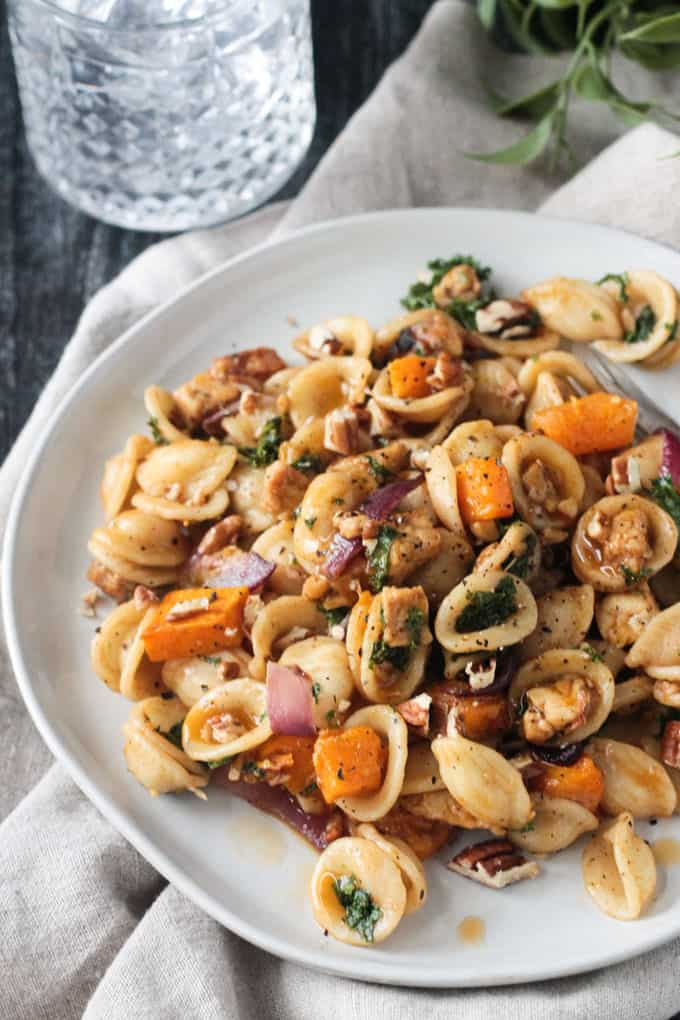 Overhead view of a plate of pasta with roasted fall vegetables