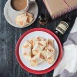 Plate of polish christmas cookies next to a mug of coffee